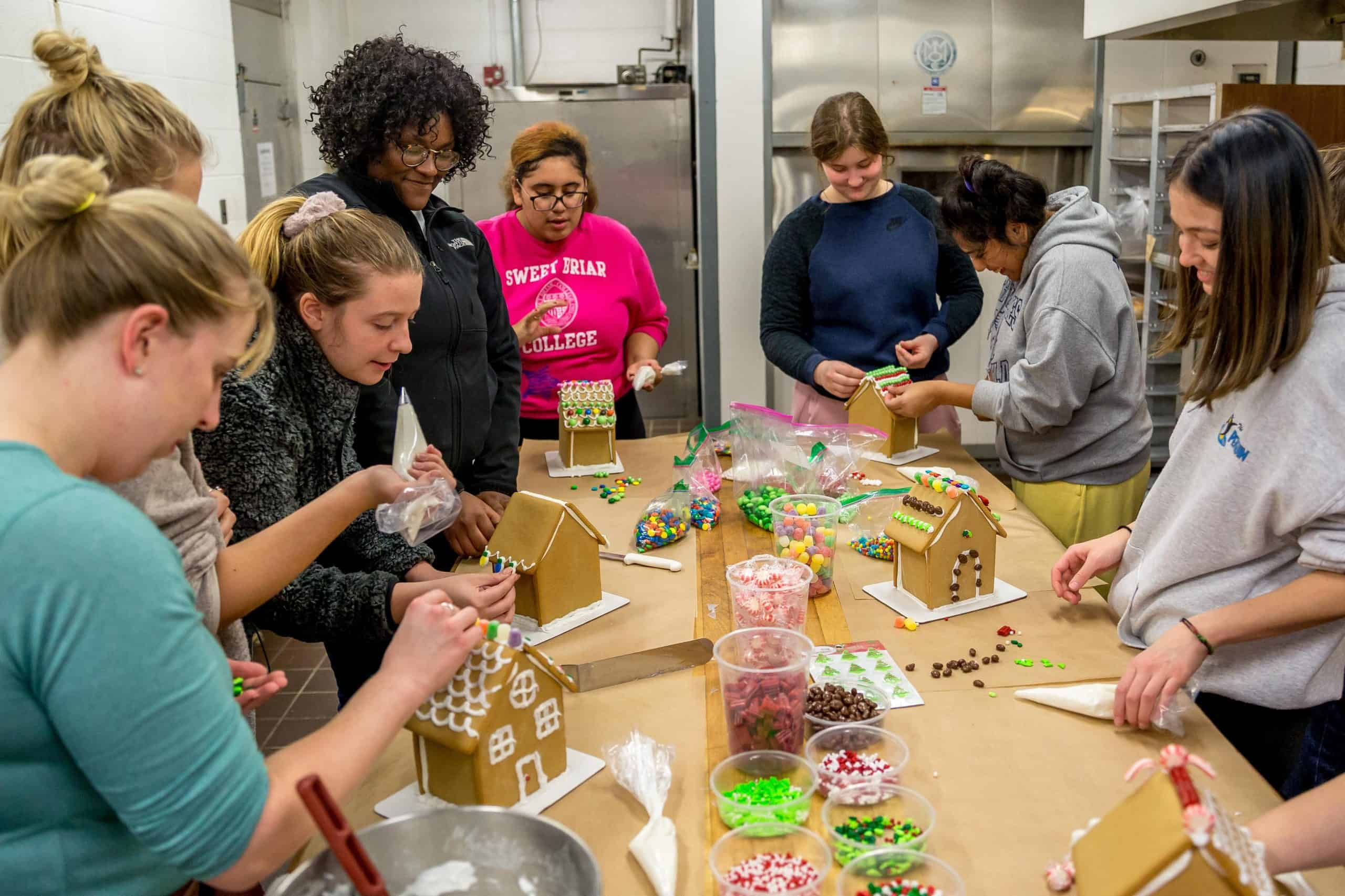Students decorating gingerbread houses