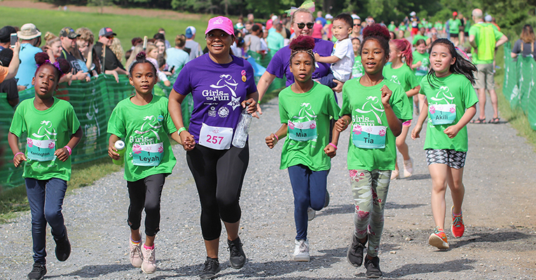 Girls on the Run participants (in green shirts) in Spring 2019