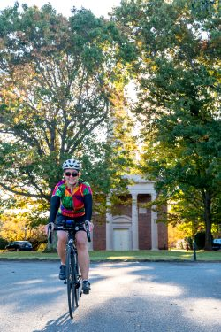 Dean Garrett riding her bike around Sweet Briar campus