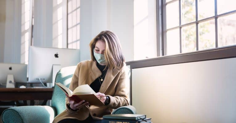 Siena Annable reads a book in the library