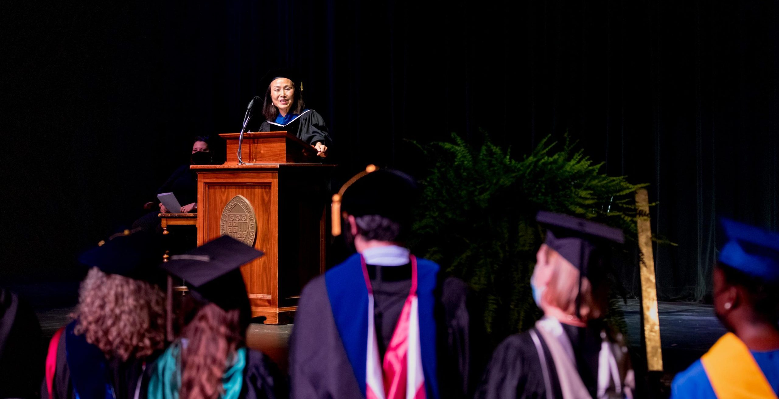 President Meredith Woo welcomes new faculty