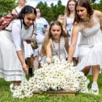 Laying daisies on the Williams' graves