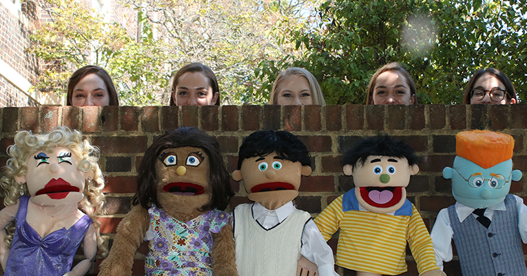 """Avenue Q"" players and puppets. Photo by Kye Hayslette."