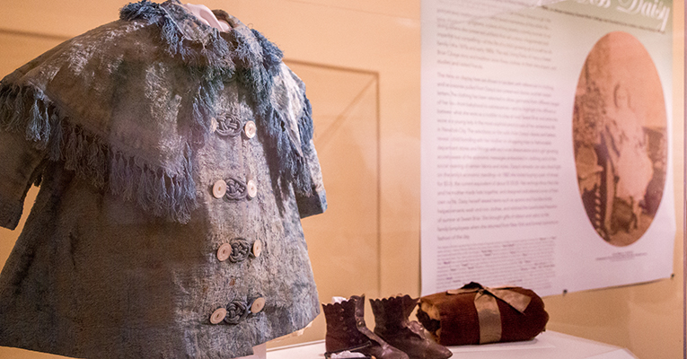 "A tiny coat and shoes are among the items on display in ""Dressing Miss Daisy,"" a new exhibit in the Sweet Briar Museum's Whitley Gallery."