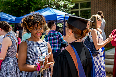 Students, faculty and staff mingle after convocation.