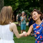 President Woo smiles at student during Daisy Ceremony