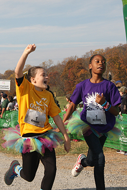 Runners approach the finish line during the fall 2016 Girls on the Run 5K at Sweet Briar.