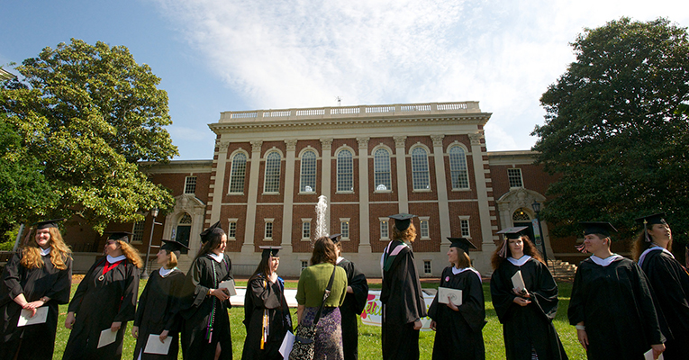 Graduates in front of the library