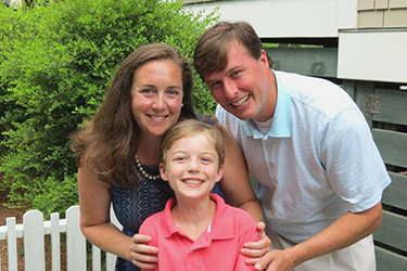 Julia Ambersley '01 with her husband, Robbie, and their son, Gus, age 9