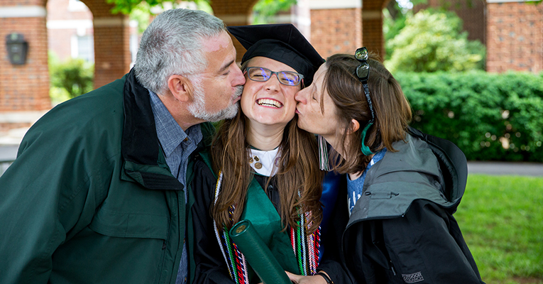 2017 graduate and her parents at commencement.