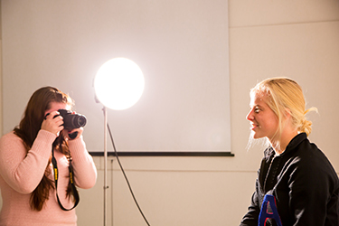 Students experiment with studio lighting.