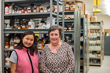 Madeline Widjaja and Pam Simpson in the chemistry stockroom.