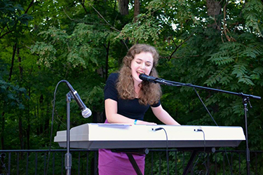 A songwriter performing at the Writers Café during the summer 2015 Young Writers Workshop at Sweet Briar College. Photo courtesy of Jeff Martin.