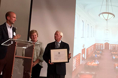Lorenzo Battistelli (left) and Joe Malloy accept the 2016 Gabriella Page Preservation Award from Preservation Virginia's Anne Geddy Cross. Photo by Lauranett Lee