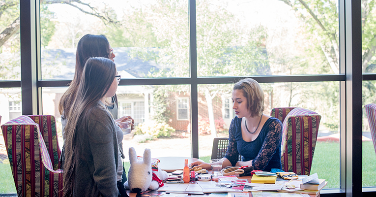 """Lauren Rose """"Velocity"""" Haigh of Tacoma presents research during the Pannell Scholars academic fair at Sweet Briar College in Virginia."""