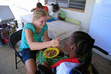 Allison McLamb feeds a resident of West Haven Children's Home.