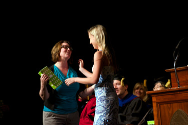 Annie Jones (left) receives an SGA Excellence in Service Award from Katie Craig.