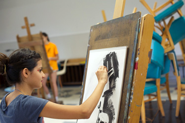 A student works on a charcoal drawing during the 2012 Blue Ridge Summer Institute for Young Artists.