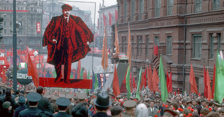 "Huge posters dominate the scene as masses of people gather for a ""demonstratsiya"" on Red Square in 1970 to celebrate May 1st, International Workers Day."