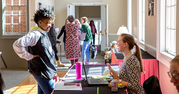 Emily Dodson (right) welcomes current first-year Ajhani Oxendine during Accepted Applicants Weekend earlier this year.