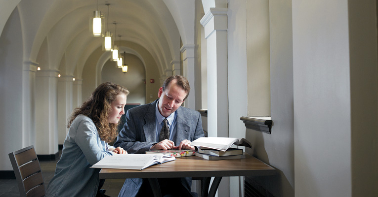Professor Eric Casey and Susannah Higginbotham '15 work on reading a Middle Egyptian text in Cochran Library.