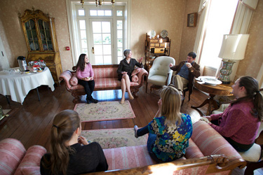 President Jo Ellen Parker (center) recognized members of Sweet Briar's Ethics Bowl team and their coach, assistant professor of philosophy Kevin Honeycutt, by hosting a tea in their honor. Sweet Briar placed second in the annual debate among VFIC members.
