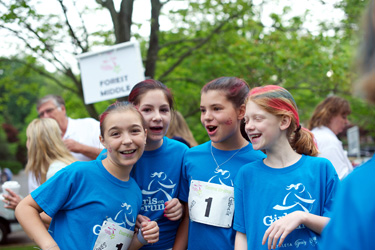 """Happy hair"" and face decorations fuel the girls' pre-race excitement."