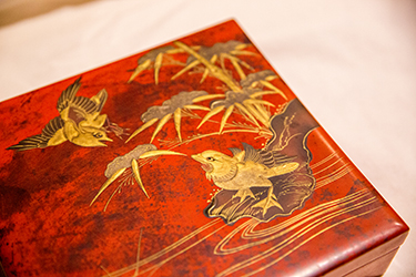 A detail of a Japanese decorative art box shows a style that became popular among wealthy 19th-century Americans.