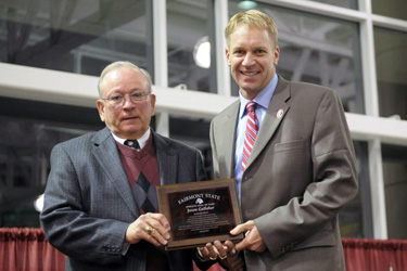 Jason Gallaher (right) receives his Hall of Fame plaque from Mike Arcure, chair of the Fairmont State Athletic Association Hall of Fame Committee. Photo courtesy of John Piscitelli, FSU.