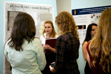 "Jessica Barry '16 talks about her topic, ""Vox Populi: Latin Epigraphy at Ephesus from the 1st Century C.E.,"" during the poster presentation session."