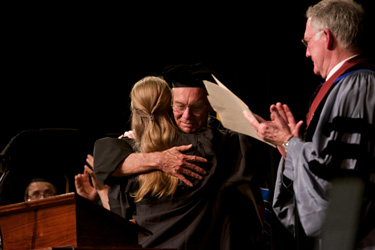 President Jones (right) applauds Jim Kirkwood, one of three recipients of the Excellence in Teaching award.