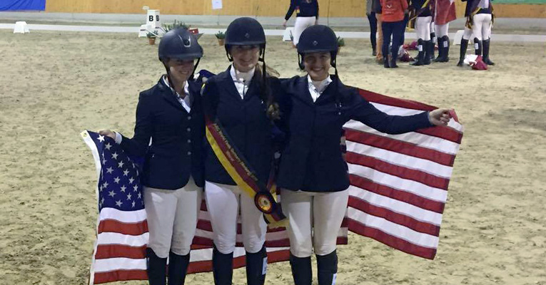 Makayla Benjamin '18 (center) won the Silver League show jumping competition and was third overall in the AIEC Student Riding Nations Cup World Finals in Germany.
