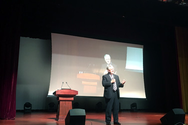 President Stone speaking at event in China
