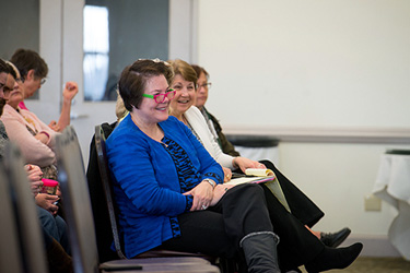 President's council members Nancyellen Keane '78 (left), the College's general counsel, and Academic Dean Pam DeWeese react during President Stone's address.