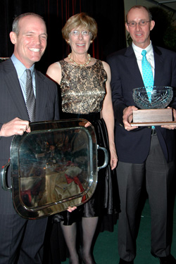 Shelby French is flanked by USHJA president Bill Moroney, who presented her the Volunteer of the Year award, and last year's winner, Geoff Teall.