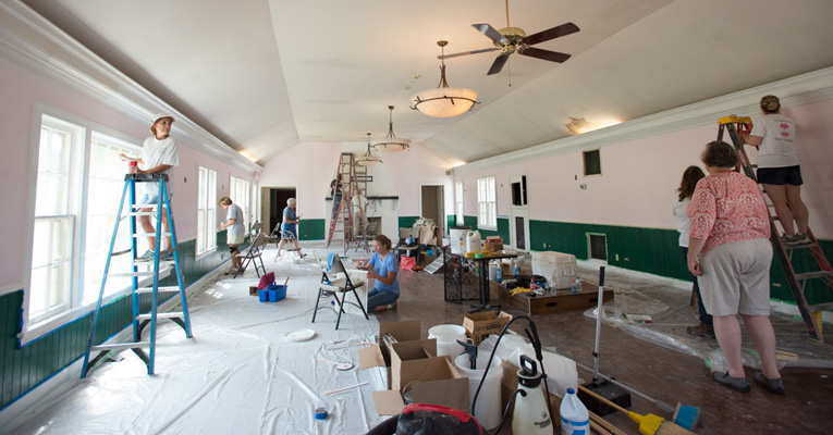 Workers ripped down old wallpaper, washed away mildew and painted the Vixen Den — hunter green and pale pink.
