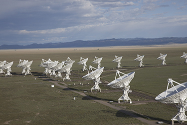 The Karl G. Jansky Very Large Array consists of 27 230-ton dish antennas that together comprise a single radio telescope system. Image courtesy of NRAO/AUI and NRAO.